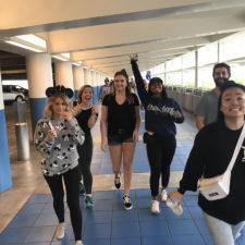 Employees heading to Disneyland. Everyone looks happy.