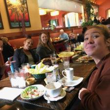 Four women employees at an eating establishment.