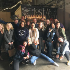 A dozen or so employees at a brewery