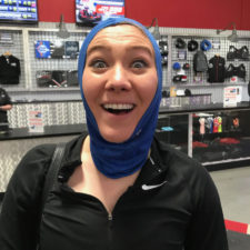 A woman a sporting good's store wearing Nike gear